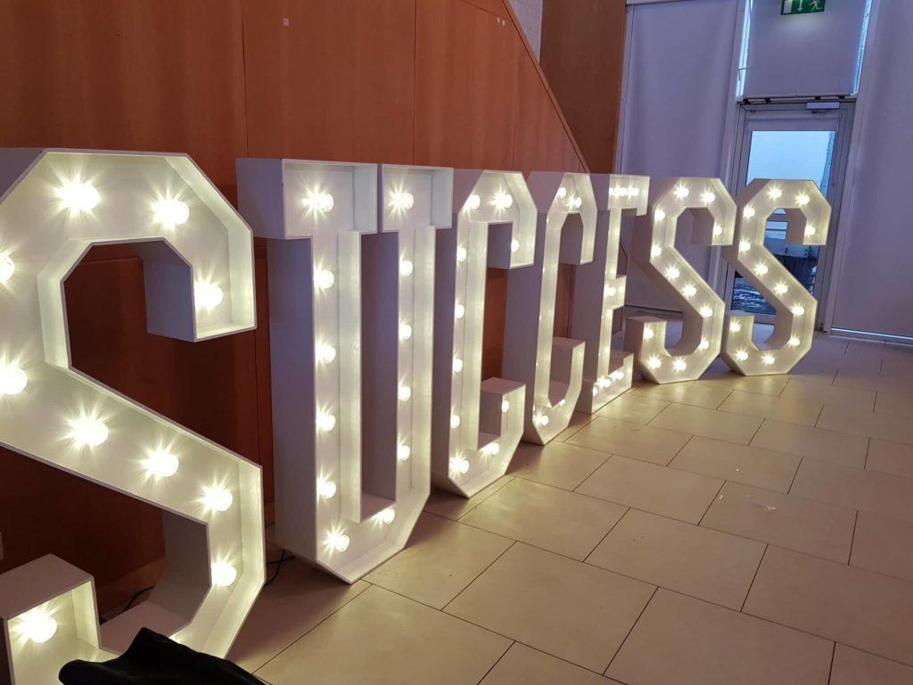 success corporate events decor giant letters